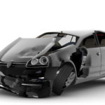 An accident with a black car isolated on white
